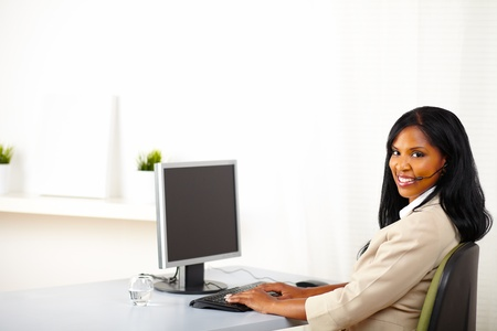 Portrait of a young attractive call center operator at work photo