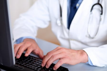 Portrait of professionals doctor hands working on computer Stock Photo - 13734385