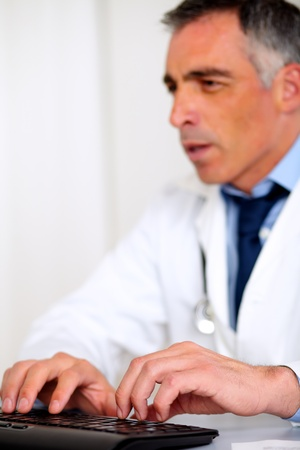 Portrait of a professional medical specialist working at the hospital photo