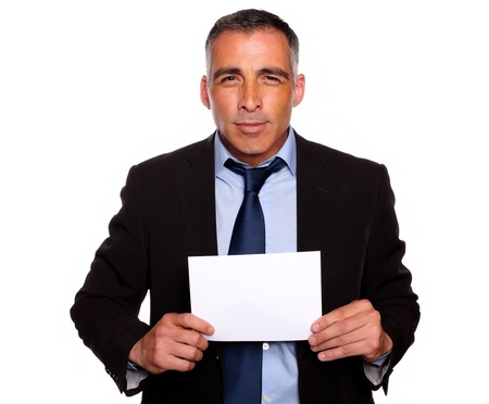 Portrait of a successful manager looking and holding a white card with copyspace on isolated background photo