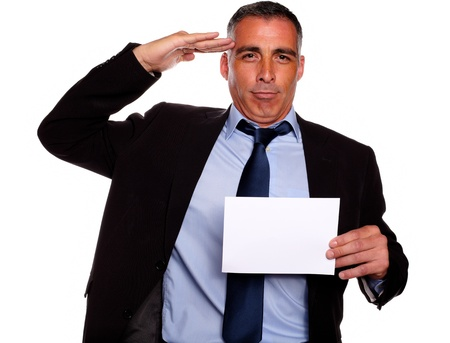 Portrait of a professional friendly senior executive greeting and holding a white card with copyspace against white background photo