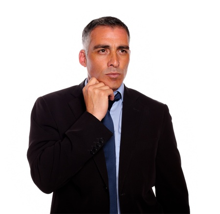 attractive charismatic: Portrait of a charismatic attractive man on black suit thinking against white background Stock Photo