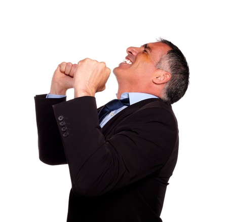 charismatic: Portrait of a hispanic senior broker celebrating very happy a victory on isolated background Stock Photo