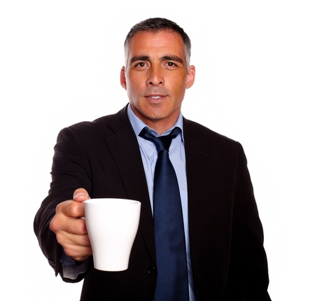 Portrait of a attractive executive with a white mug asking you for fill it against white background photo