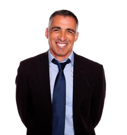 attractive charismatic: Portrait of a friendly hispanic businessman on black suit smiling with the arms on the back against white background