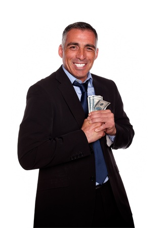 Portrait of a hispanic executive holding plenty of cash money while show it on isolated background Stock Photo - 13891223