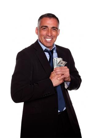 Portrait of a hispanic executive holding plenty of cash money while show it on isolated background Stock Photo - 13891223