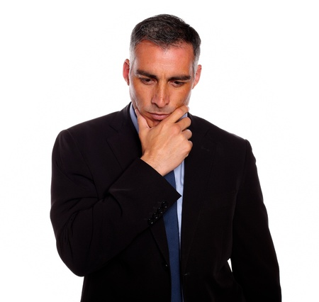 Portrait of a adult and reflective man touching the chin while thinking on black suit on isolated background photo