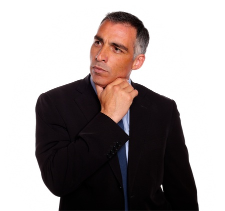 Portrait of a attractive hispanic broker meditative while thinking on black suit on isolated background photo