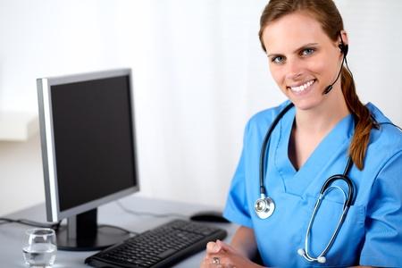 Portrait of a caucasian medical secretary smiling at hospital callcenter Stock Photo - 13963487
