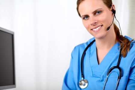 Portrait of a beautiful blonde medical secretary smiling at hospital Stock Photo - 14135339