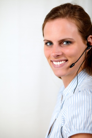 Close up portrait of a beautiful blonde secretary smiling at call center photo
