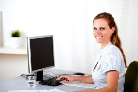 Portrait of a attractive blonde receptionist working at work desk