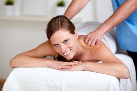 Portrait of a attractive woman receiving a body massage at a spa resort photo