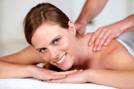 Close-up portrait of a young woman receiving a body massage at a spa resort Stock Photo - 14248046