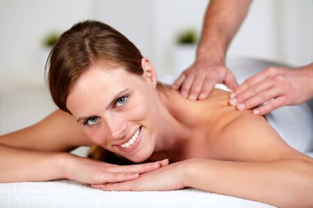 Closeup portrait of a young female receiving a relaxed massage at a spa Stock Photo - 14248011