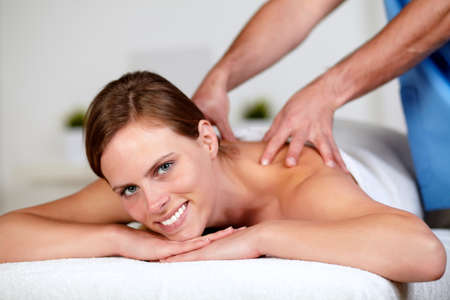 Close up portrait of a beautiful young woman getting a massage at spa resort Stock Photo - 14247993