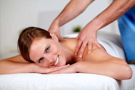 Close up portrait of a beautiful young woman getting a professional massage at spa resort Stock Photo - 14247999