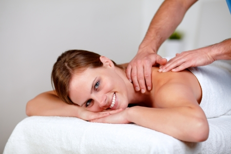 Portrait of a charming young blonde woman relaxing at a spa while receiving a massage at spa resort copyspace photo