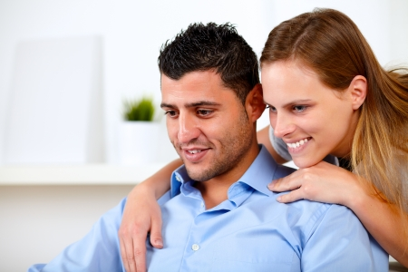 Portrait of a beautiful couple in love looking something at home indoor Stock Photo