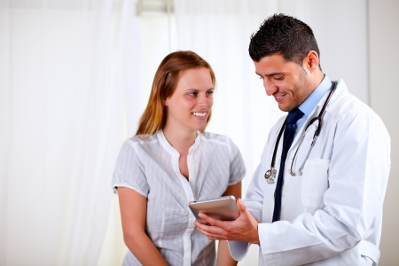 Portrait of a professional medical doctor with a patient at hospital indoor photo