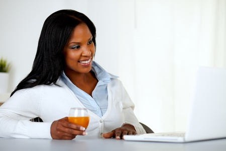 Portrait of a pretty young girl relaxing on laptop at soft colors composition photo