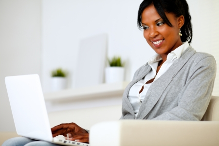 Portrait of an afro-american young girl using laptop at home indoor Stock Photo - 14547727