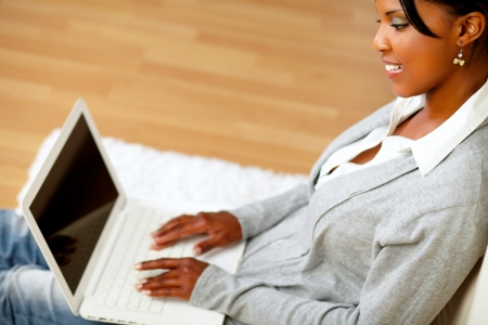 Top view portrait of an attractive woman working on laptop at home indoor photo