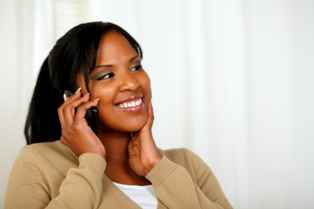 conversing: Portrait of a fresh woman smiling and conversing on mobile Stock Photo