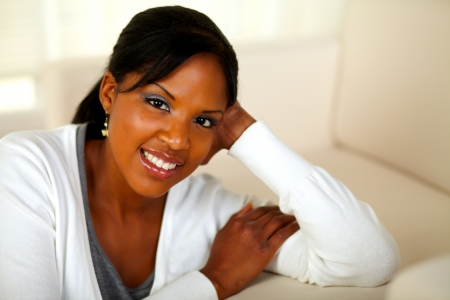 Portrait of a charming black female looking and smiling at you. With Copyspace photo
