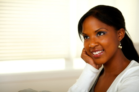 Portrait of a relaxed afro-American young female smiling. With copyspace photo