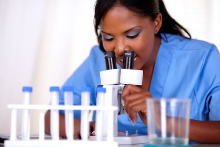 Medical doctor female working with a microscope at hospital - portrait Stock Photo - 15100283
