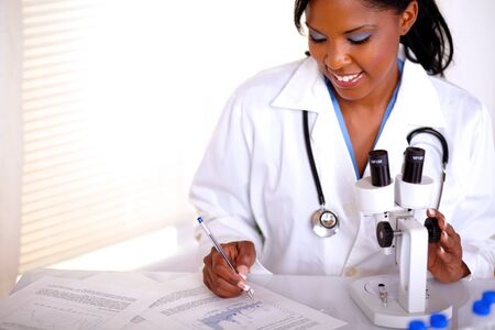Medical doctor young woman working at laboratory with documents - copyspace photo