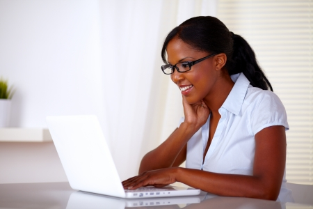 Attractive woman with black glasses working on laptop at workplace - copyspace Stock Photo - 15154874