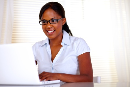 Pretty female with black glasses working on laptop at office - copyspace Stock Photo - 15154851