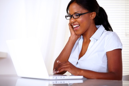 Young pretty secretary working on laptop at workplace - copyspace Stock Photo - 15154859