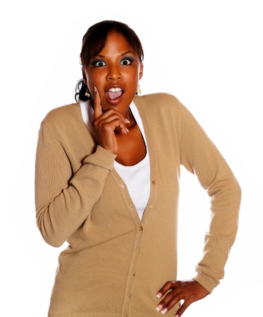 Afro-american young woman screaming while looking at you on isolated background photo