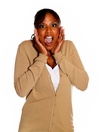 Afro-american young woman screaming at you on isolated background photo