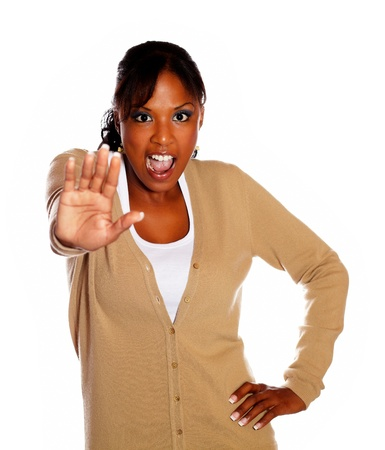 Young woman screaming and giving the high against white background photo