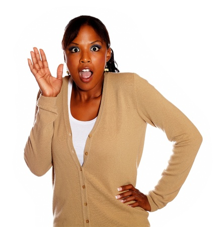 Surprised charming girl with hand up against white background