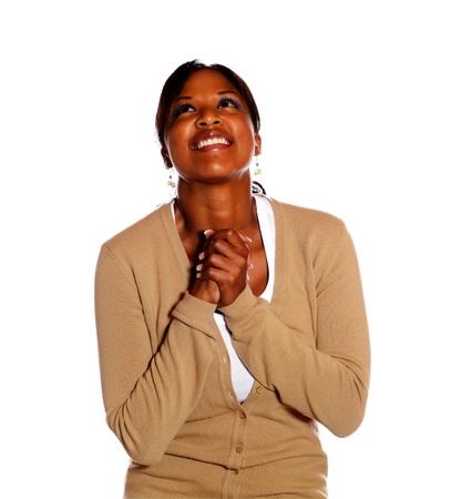 woman looking up: Excited happy black woman looking up on isolated background Stock Photo
