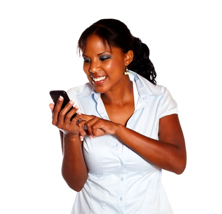 Young woman sending a message by cellphone on isolated background photo