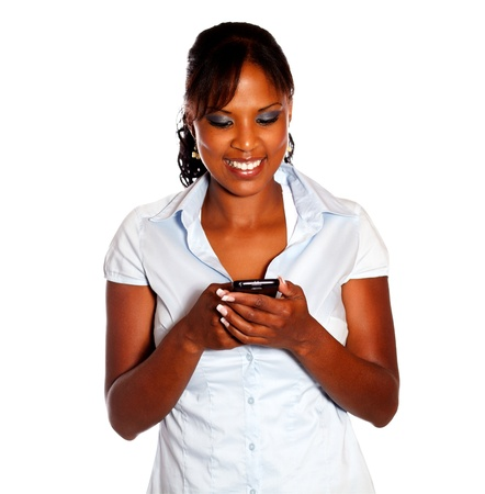 Charming young woman sending message by cellphone on isolated background photo