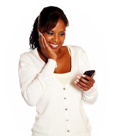 Adult woman sending message on mobile phone on isolated background photo