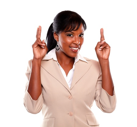 Young executive woman looking at you while crossing fingers against white background Stock Photo - 15599775