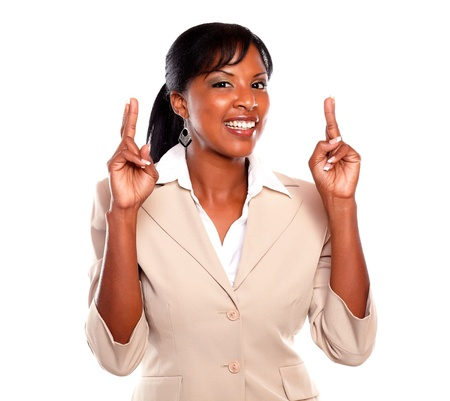 Young businesswoman looking at you while crossing fingers against white background Stock Photo - 15691562