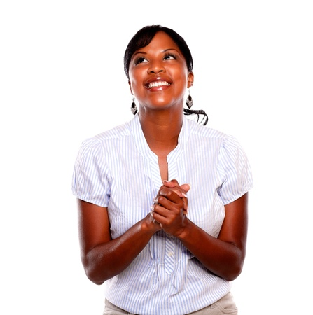 Smiling afro-american woman celebrating and looking up against white background Stock Photo - 15784071