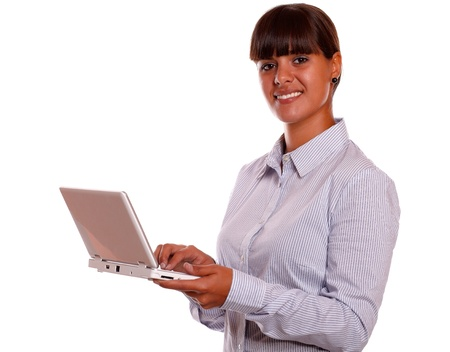 Portrait of a stylish young woman working with laptop computer against white background photo