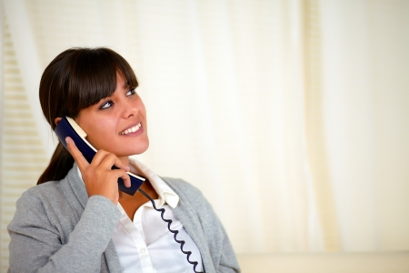 Portrait of a adult woman looking up and speaking on phone - copyspace Stock Photo - 17071238