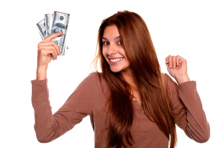 Portrait of a charming young woman with cash money with long brow hair against white background photo